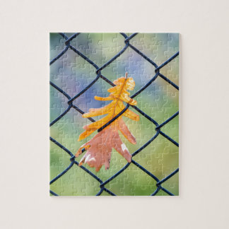 Fall Leaf Caught on a Fence Jigsaw Puzzle