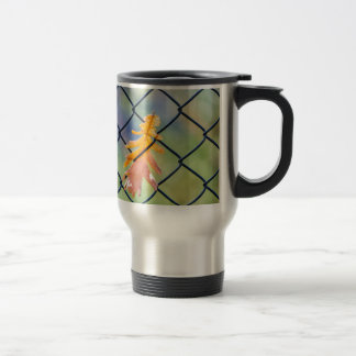Fall Leaf Caught on a Fence Travel Mug