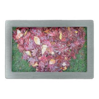 Fall Leaves Raked into Heart Shape on Green Grass Belt Buckle