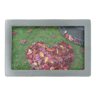 Fall Leaves Raked into Heart Shape on Green Grass Rectangular Belt Buckle