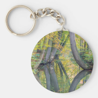Fall tree trunks with reflection in forest water keychain