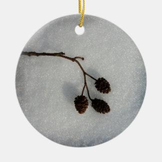 fallen twig round ceramic ornament
