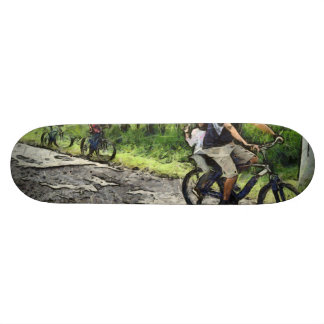 Family cycling on a dirt track skateboards