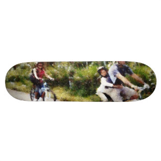 Family enjoying a cycle ride skate boards