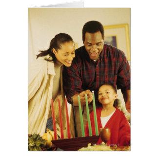Family lighting the Kinara for Kwanzaa Card