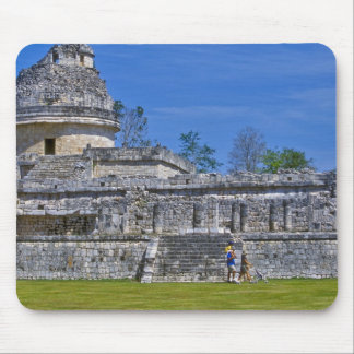 Family of tourists walk past ancient Mayan Mouse Pad