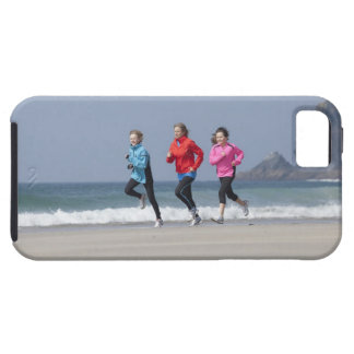 Family running together on beach iPhone 5 cover