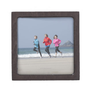 Family running together on beach premium keepsake boxes