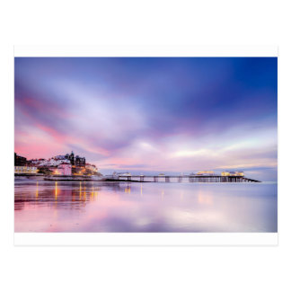 Famous Cromer pier in Norfolk England with pink su Postcard