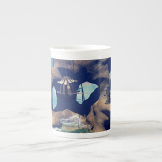 Fantasy landscape with a rock in the ocean tea cup