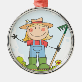 Farmer girl with a rake in grass metal ornament