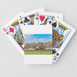 Farmer on tractor plowing sandy soil in spring bicycle playing cards