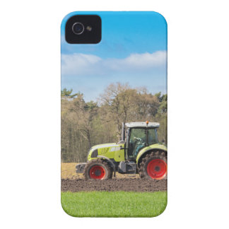 Farmer on tractor plowing sandy soil in spring Case-Mate iPhone 4 cases