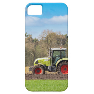 Farmer on tractor plowing sandy soil in spring iPhone 5 case