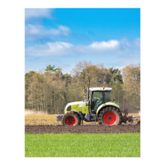 Farmer on tractor plowing sandy soil in spring letterhead template