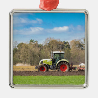 Farmer on tractor plowing sandy soil in spring Silver-Colored square ornament