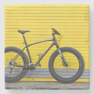 Fat bike on yellow wall stone coaster