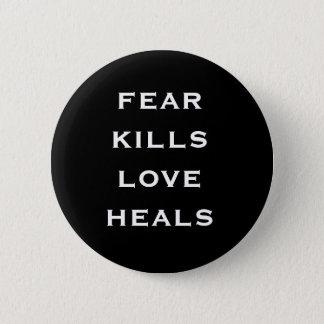 fear kills love heals 2 inch round button