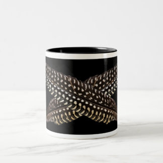 Feathers are symbols of spiritual ascension Two-Tone coffee mug
