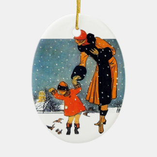 Feeding Birds in the Snow Ceramic Ornament