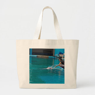 Feeding the dolphins as part of Dolphin show Tote Bag