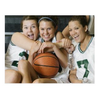 Female basketball team smiling, portrait postcard