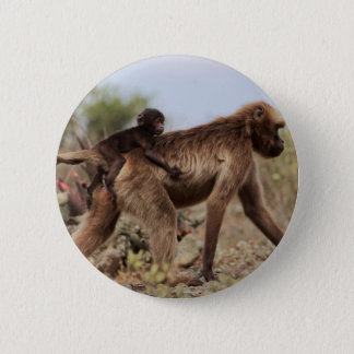 Female gelada baboon with a baby 2 inch round button
