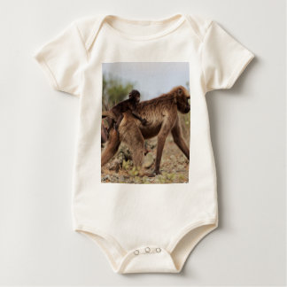 Female gelada baboon with a baby baby bodysuit