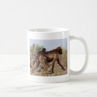 Female gelada baboon with a baby coffee mug