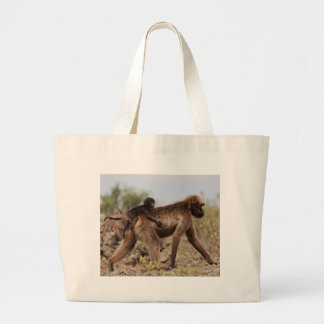 Female gelada baboon with a baby large tote bag