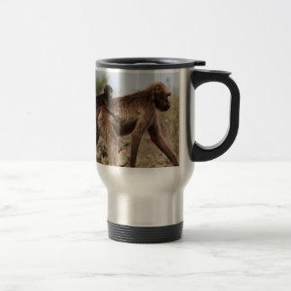 Female gelada baboon with a baby travel mug
