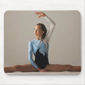 Female gymnast (12-13) performing splits mouse pad
