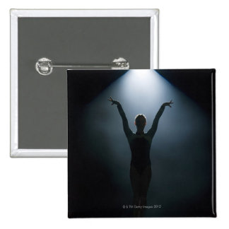 Female gymnast performing in spotlight, studio 2 inch square button