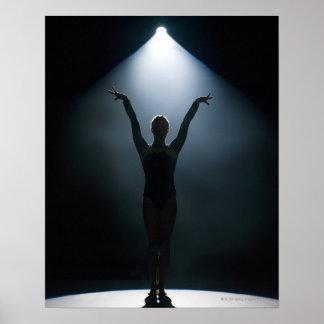 Female gymnast performing in spotlight, studio poster
