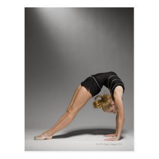 Female gymnast stretching, studio shot 2 postcard