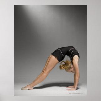 Female gymnast stretching, studio shot 2 poster