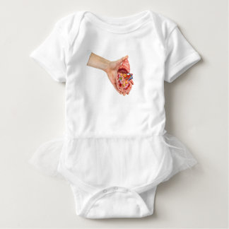 Female hand holds model of human kidney baby bodysuit