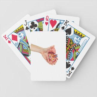 Female hand holds model of human kidney poker deck