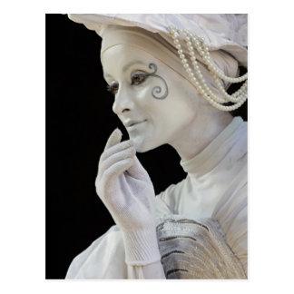 Female mime performing on street corner postcard