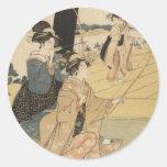 Femelles japonaises pratiquant le tir à l'arc C. Autocollant Rond