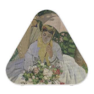 Femmes dans le jardin, coordonnée d'une femme assi haut-parleur bluetooth