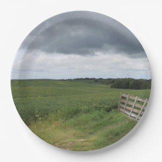 fence gate in front of field with mowed horseshoe paper plate