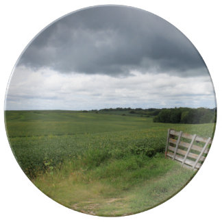 fence gate in front of field with mowed horseshoe plate