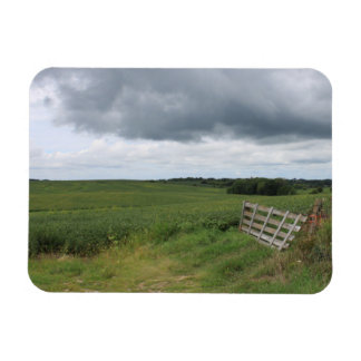fence gate in front of field with mowed horseshoe rectangular photo magnet