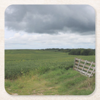 fence gate in front of field with mowed horseshoe square paper coaster