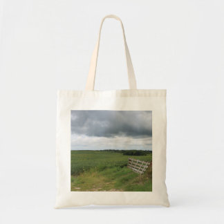 fence gate in front of field with mowed horseshoe tote bag