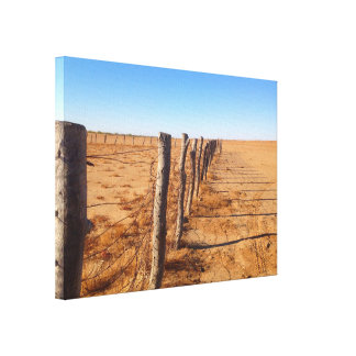 Fence in the desert canvas print