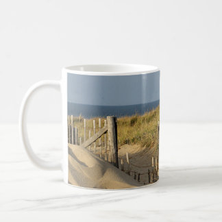 Fence in the dunes coffee mug