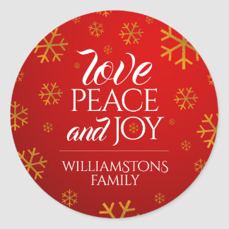 Festive Red Love, Peace, and Joy with Snowflakes Classic Round Sticker