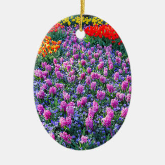 Field of pink hyacinths and red tulips ceramic oval ornament